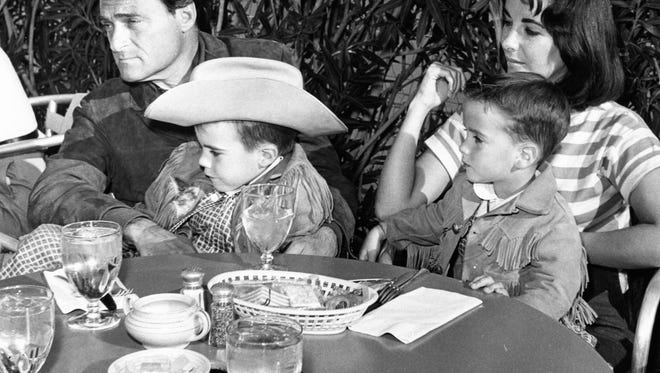 Mike Todd and his wife, Elizabeth Taylor with her son's at the Racquet Club c. 1950.