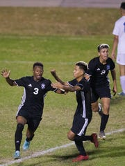 Mariner High School's Tobias McKay, left, Alex Franco and Leo Perez celebrate McKay's goal against Cape Coral during the District 3A-13 soccer championship game on Friday at Mariner High School in Cape Coral. Mariner beat Cape 2-0.