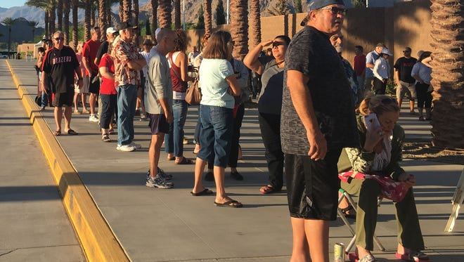 Residents of Coachella Valley line up in order to buy tickets to Desert Trip concert in October. Tickets went on sale for locals only at 8 a.m. at the Indian Wells Tennis Gardens.