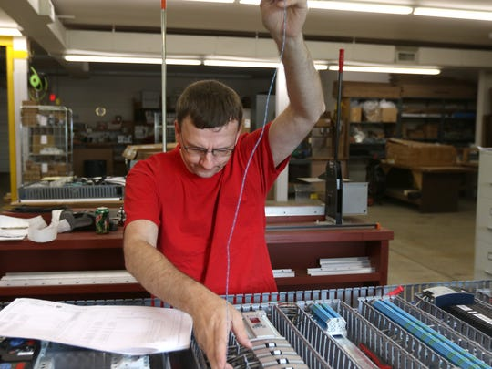 Ed Kohl, a process controls technician for ESE, Inc., performs engineering on a product May 24, 2016.