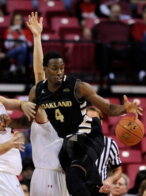 Oakland forward Jalen Hayes (4) loses the ball while going up to shoot as Maryland forward Michal Cekovsky defends during the first half of an NCAA college basketball game Saturday, Dec. 27, 2014, in College Park, Md.