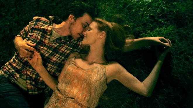"Jessica Chastain and James McAvoy snuggle in ""The Disappearance of Eleanor Rigby."""