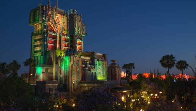 The exterior of The Collector's Fortress shimmers as night falls at Disney California Adventure Park.