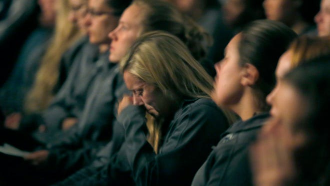 Jenna Gibbons wipes her tears during the remembrance ceremony in the Kuhl Gymnasium of the SUNY Geneseo campus for Kelsey Annese, 21, of Webster and Matthew Hutchinson, 24, of North Vancouver, British Columbia, who were stabbed to death by former student, Colin Kingston.