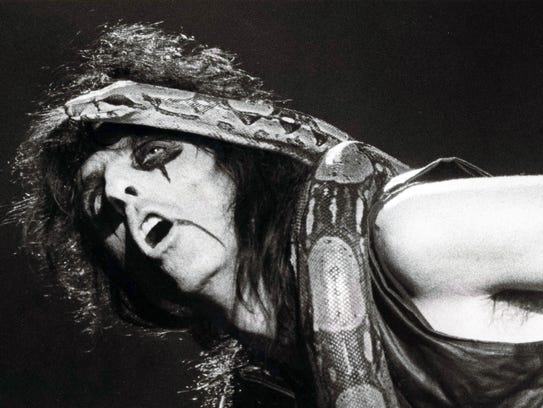 Alice Cooper sings to his pet boa constrictor during