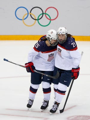 Teams USA forward Hilary Knight (21) congratulates forward Alex Carpenter (25) for her goal during the 2014 Olympics.