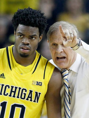 U-M coach John Beilein gives directions to Derrick Walton Jr. during a game.