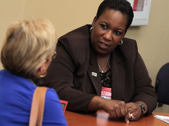 Erica Williams talks with citizens during her 2014 campaign for a seat on the Lafayette Parish School Board. Williams lost the election, but continues to be heavily involved in education issues.