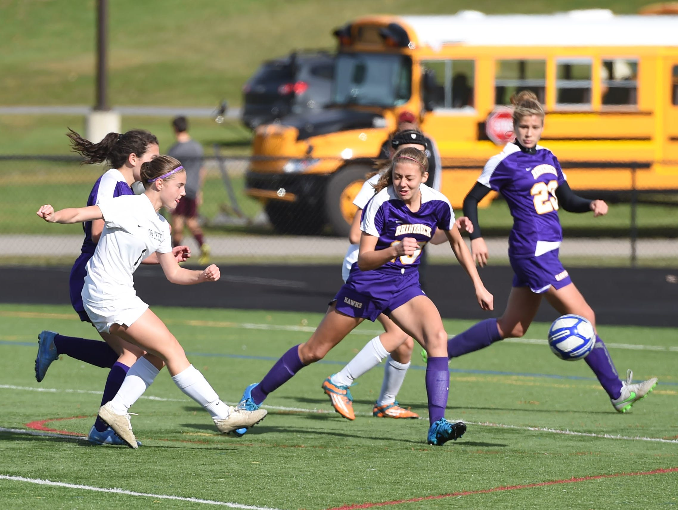 Spackenkill's Maria Barefoot shoots the ball past Rhinebeck's Amber Hoglin to score the game's winning point during the Section 9 Class C final held in Marlboro on Saturday.