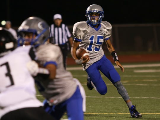 Fort Campbell High junior Abdel Howard (15) runs the ball during their game against Trigg County at Fryar Stadium on Friday.  Fort Campbell won the game 35-14.