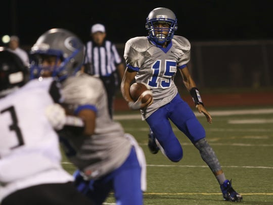 Fort Campbell High junior Abdel Howard (15) runs the