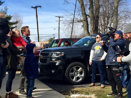 "George Oliphant introduces the Spencer family from Roxbury while filming an episode of  ""George to the Rescue."""