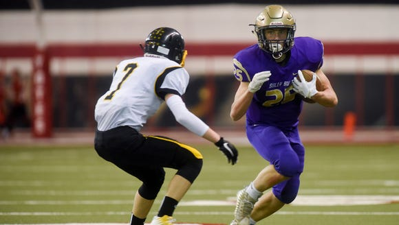 Sully Buttes wide receiver Grant Johnson (25) runs