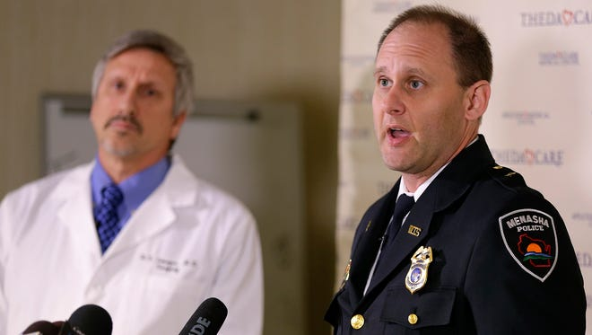 Menasha Police Chief Tim Styka, right, speaks during a news conference Monday, May 4, 2015, at Theda Clark Medical Center in Neenah, Wis. Menasha, Wis., police continue to investigate a shooting spree on Sunday, May 3, 2015, that left four dead and one injured on the Fox Cities Trestle Trail bridge in Menasha. Also pictured is Dr. Raymond Georgen, the medical director of trauma at Theda Clark Medical Center.