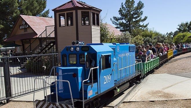 Loads of kids and adults fill the open-air cars during a train ride at McCormick- Stillman Railroad Park in Scottsdale.