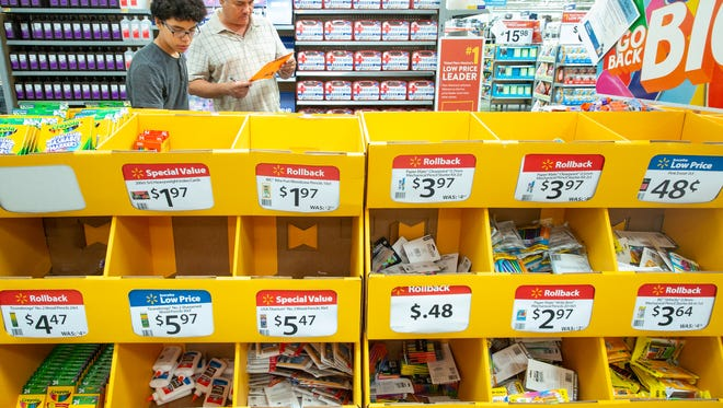 Andres Uribe, 13, shops for school supplies with his dad David on Saturday, August 4, 2018, at Walmart located on Rinconada Boulevard during tax-free weekend.