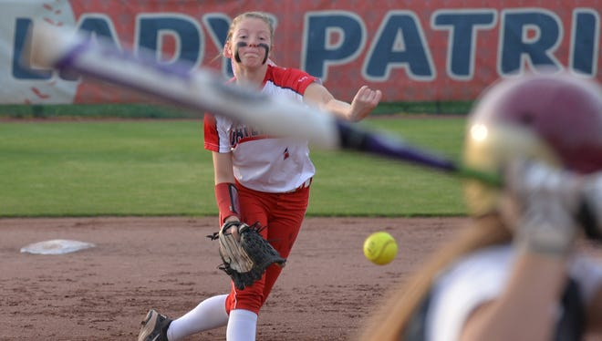 Oakland's Lacie Rinus fires a pitch against Riverdale on Monday. Oakland won 3-2.