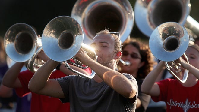 Central High School's Spirit of Muncie band rehearses at Central High School for a competition in the summer of 2014.
