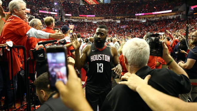 Houston Rockets guard James Harden (13) retires to the locker room after defeating the Golden State Warriors in game five of the Western conference finals of the 2018 NBA Playoffs at Toyota Center.