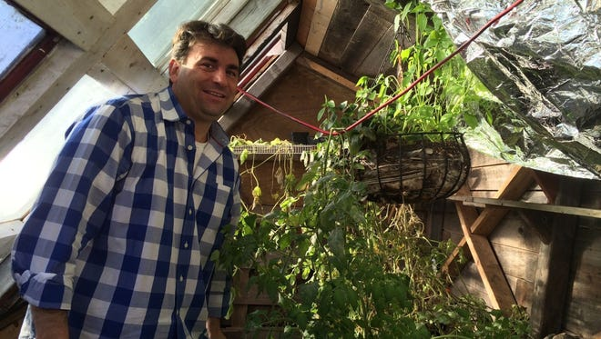 Volunteer Greg Strong inside the walipini.