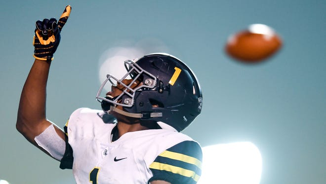 Lausanne's Eric Gray has committed to Michigan.