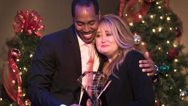 Leadership Jackson 2016 Vice Chair Pierre DuVentre embraces Vadessa Flack of the Jackson Symphony while presenting her with the Diamond Award on Thursday, Dec. 14, 2017, during a graduation ceremony for Jackson ChamberÕs 2017 Leadership Jackson class at the Carl Grant Events Center at Union University.