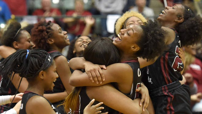 The Lawrence County Lady Cougars celebrate after beating Byhalia on Thursday in the finals of the MHSAA State Basketball Tournament at the Mississippi Coliseum in Jackson.