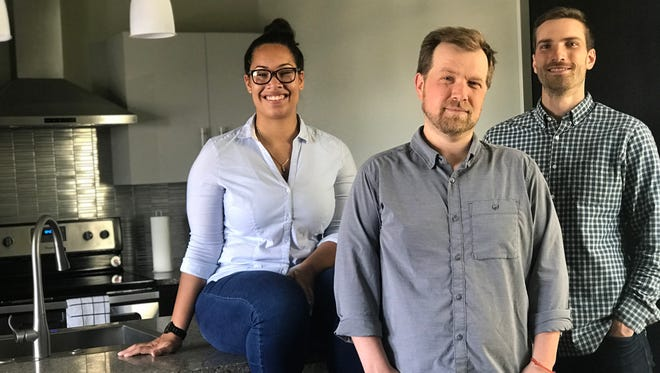 Frontdesk COO Alycia Doxon (from left), CEO Kyle Weatherly and CTO Jesse DePinto sit in one of the company's rental units in the Mackie Building on East Michigan Street in Milwaukee. The corporate housing startup has 75 units in Milwaukee, Indianapolis and Charlotte, N.C.
