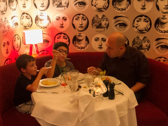 Alex Caronchi, 6, Leo, 9, and their dad, Michael, eat
