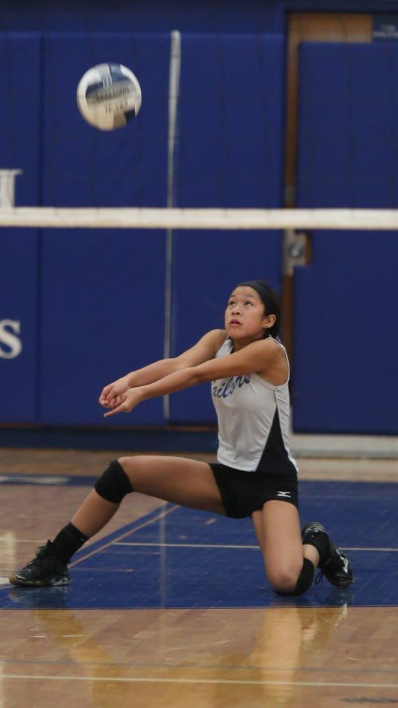 Hendrick Hudson's Pamela Loh (17) returns the ball