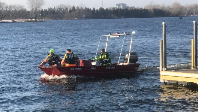 First responders from the De Pere Fire Department leave the Fox Point boat landing to investigate a report of a body in the Fox River.