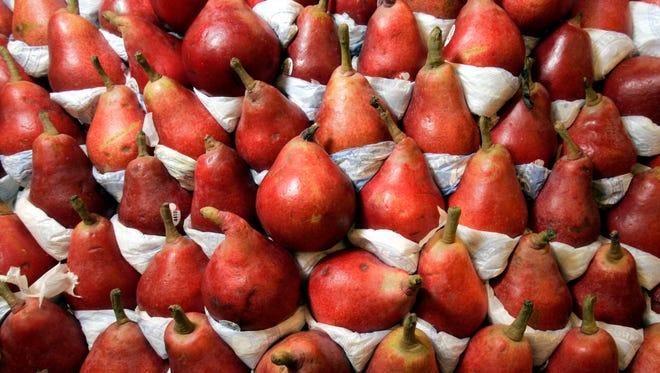 A large variety of produce, including pears, is available at the Fairway Market in Paramus, N.J.