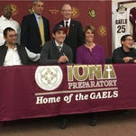 Ty Jerome with his family and coaches. The Iona Prep senior signed with the University of Virginia during a ceremony at Iona Prep on Nov. 12, 2015.