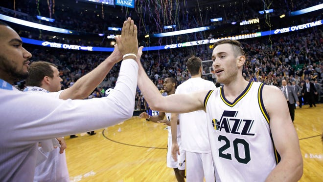 Utah Jazz's Gordon Hayward receives a high-five from Trey Lyles, left, after a game against the Indiana Pacers on Saturday, Dec. 5, 2015, in Salt Lake City.