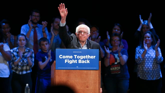 Former presidential candidate Sen. Bernie Sanders acknowledged the crowd following his speech at the Louisville Palace.  Apr. 18, 2017