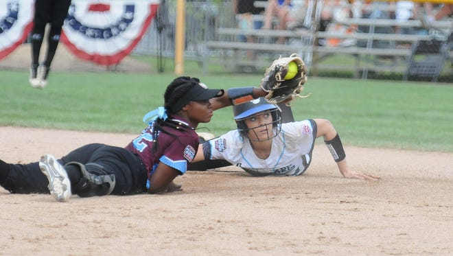 Avery Wheatley almost slides in under the tag against Southwest during the Big League Softball World Series on Saturday.