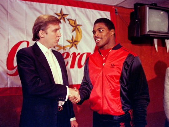 In this March 8, 1984, file photo, Donald Trump shakes