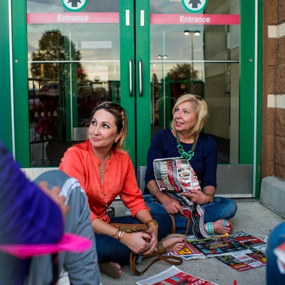 Danielle Thompson and Carol Brunson look through store