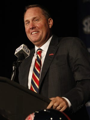 Mississippi coach Hugh Freeze speaks to media at the Southeastern Conference NCAA college football media days on Thursday, July 17, 2014, in Hoover, Ala. (AP Photo/Butch Dill)