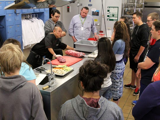 Chef Opi Sinyal of Tomo Japanese Sushi & Steak House talks to students in Eddie Gurrola's culinary essentials class on Thursday at the Career and Technology Education Center in Farmington.
