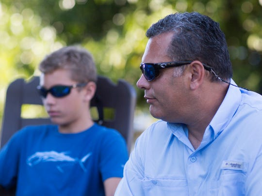 Angel Casabona and his son Jake, 12, talk about the rescue at their home on Marco Island on Wednesday, Feb. 8, 2017. The Casabona family was out boating when they rescued two off-duty Collier deputies and three kids from a sinking boat.