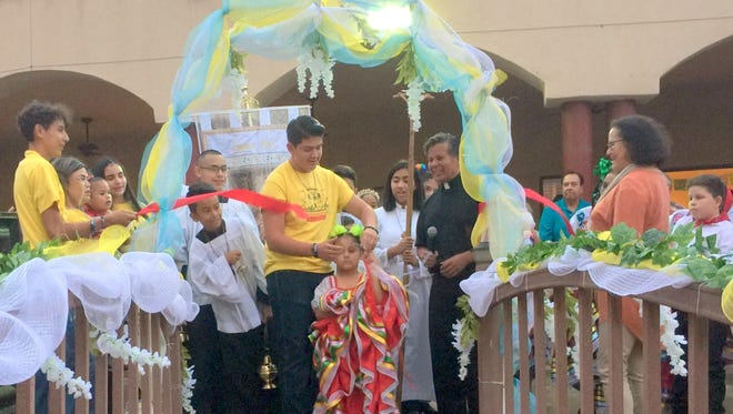 Santa Ana Catholic Church held a ribbon cutting ceremony in the church's courtyard to commemorate the 100th anniversary of the church and to kick off the month-long centennial celebration at the parish.