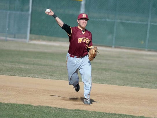 Former Mountain Home Bomber Hayden Hall throws to first