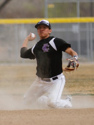 Kirtland Central's Keishaun Aspaas throws out a Navajo Prep runner at first base during their game on April 4 at Kirtland Central High School.