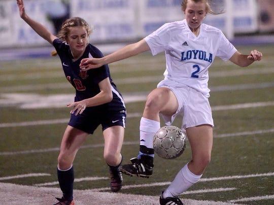 Loyola's Liz Bryan, right, tries to keep the ball away