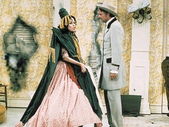 Carol Burnett (left) wears the famed Bob Mackie-designed