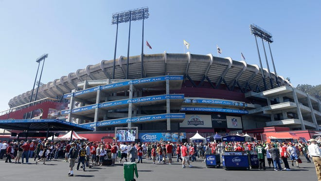 Fans walk outside of Candlestick Park before Sunday's season-opening game between the San Francisco 49ers and Green Bay Packers.