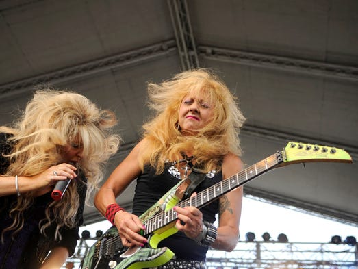 Janet Gardner and guitarist Gina Stile of Vixen head bang during a performance at Halfway Jam in Royalton on July 26th. The three day festival had many performances and two stages.