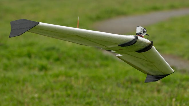 A Ritewing Zephyr II flies with a GoPro camera mounted on it over a waterfront park in Berkeley, Calif., on March 28, 2012.