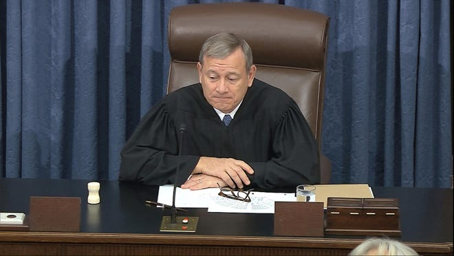 In this image from video, presiding officer Chief Justice of the United States John Roberts listens during the impeachment trial against President Donald Trump in the Senate at the U.S. Capitol in Washington, Friday, Jan. 31, 2020. (Senate Television via AP)